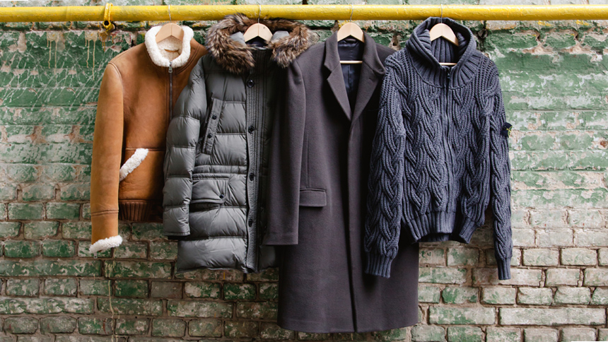 fashionable coats hanging from a pipe