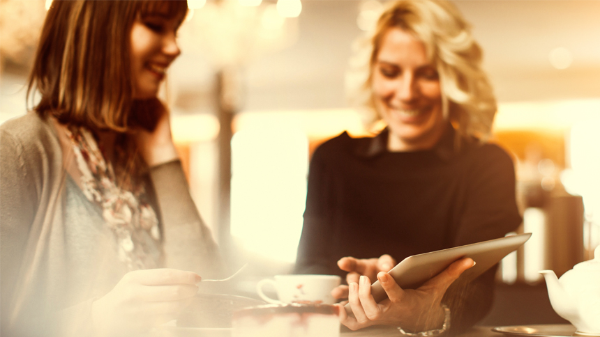 woman meeting with person at coffee shop networking