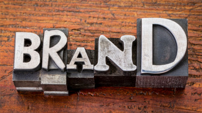 the word brand on a wood table