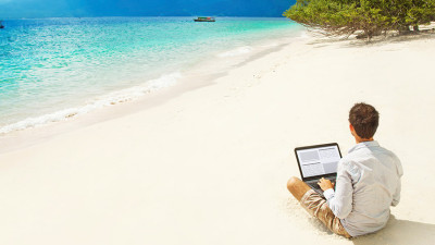 Man on beach travel writing