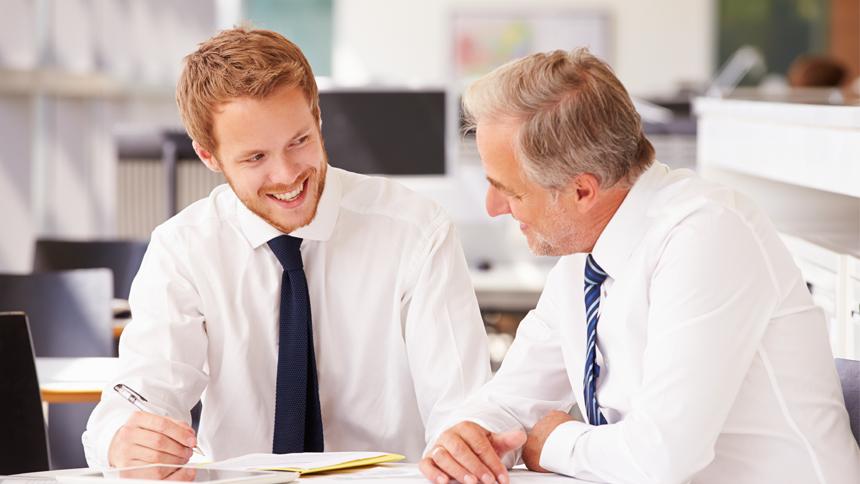 younger employee managing older employee
