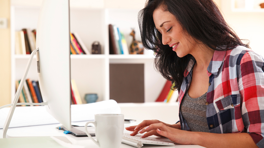 freelance writer developing a headline on a computer