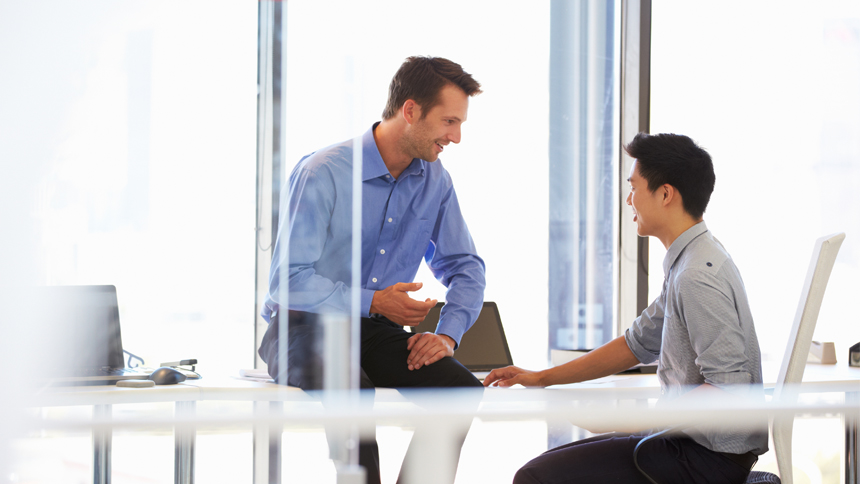 young employee meeting with his mentor in office