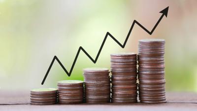 salary increasing shown through growing stacks of money