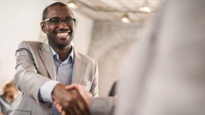 job seeker shaking hands after a job offer