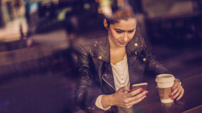 woman using a networking app on her phone