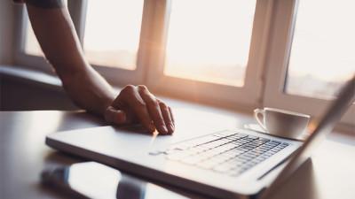 job seeker using laptop on weekend