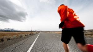 Man running a marathon on the open road