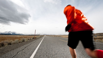 Man running a marathon on the open road