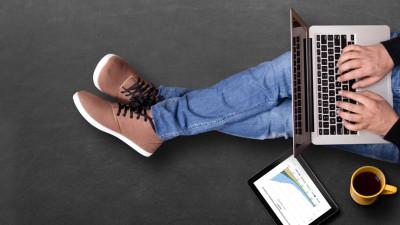 Man analyzing data on laptop