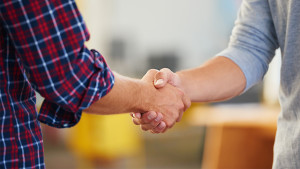 job candidate shaking the hand of a hiring manager