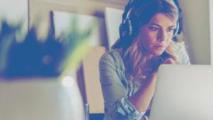 woman headphones laptop