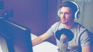 man desk microphone podcasting