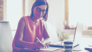 woman writing desk