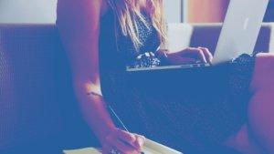 woman writing laptop