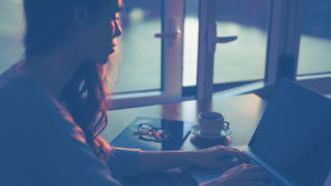 woman typing laptop